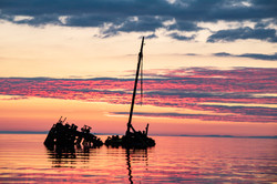 A Shipwreck at Sunset