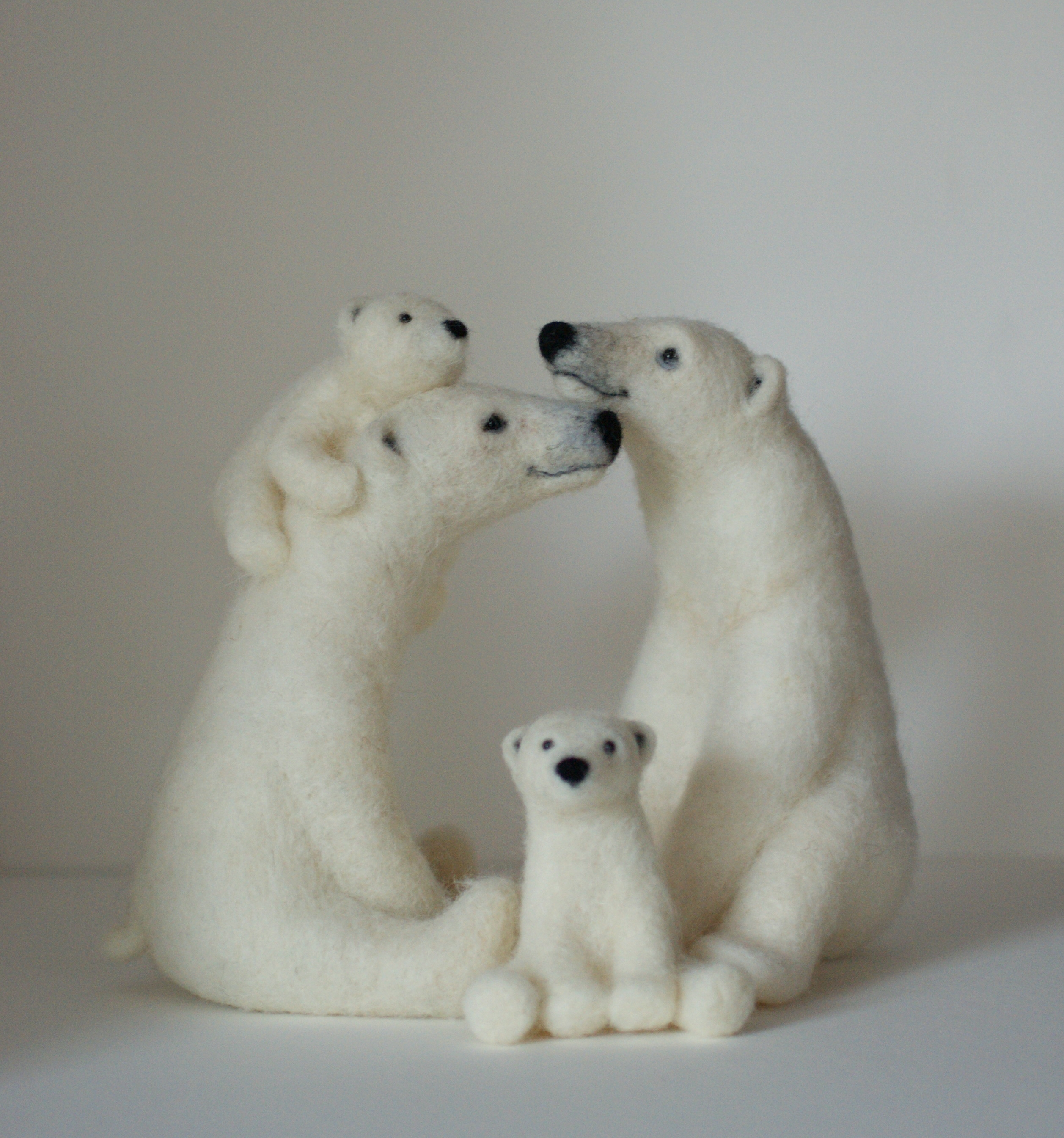 Felted polar bear family