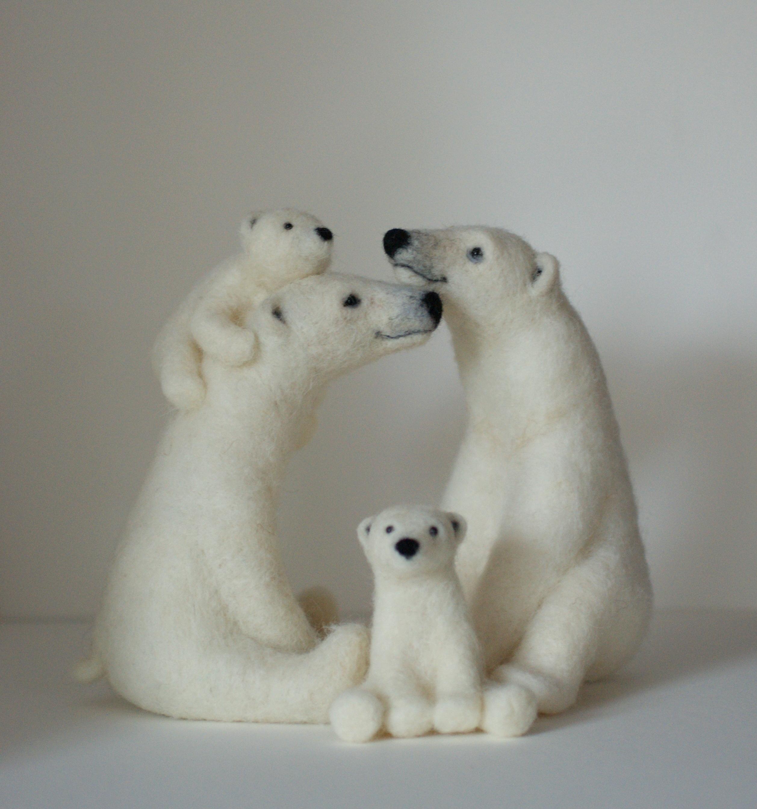 Felted polar bear family