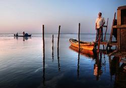 Fishermen at dusk
