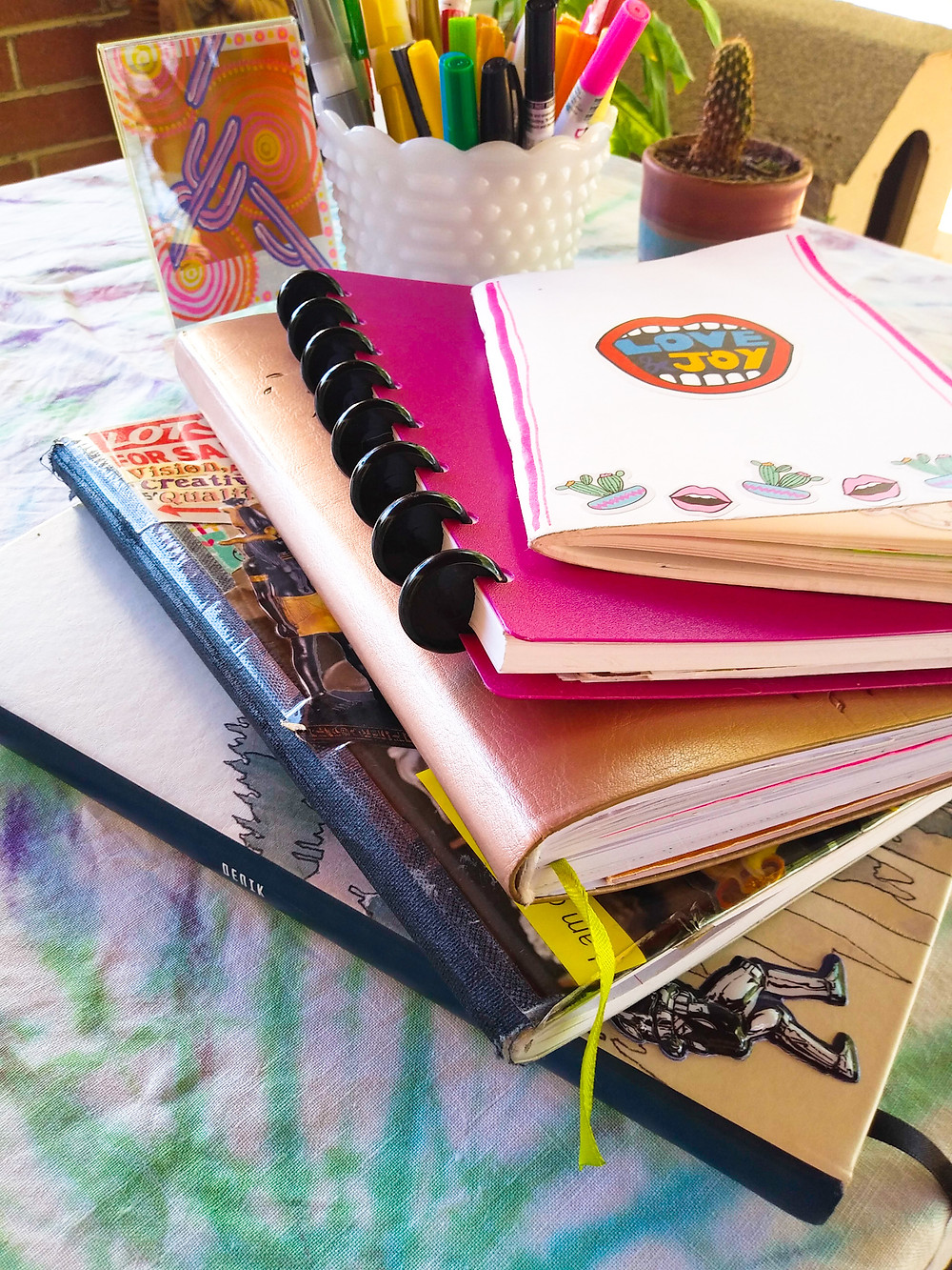 Journals, notebooks and sketchbooks used daily for organizing and managing life and work.
