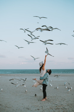 Trendy engagement photos on beach at Tybee Island