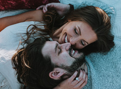 Intimate romantic engagement photos on beach on Tybee Island
