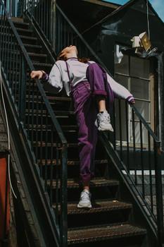 Jenni in purple overalls/pants