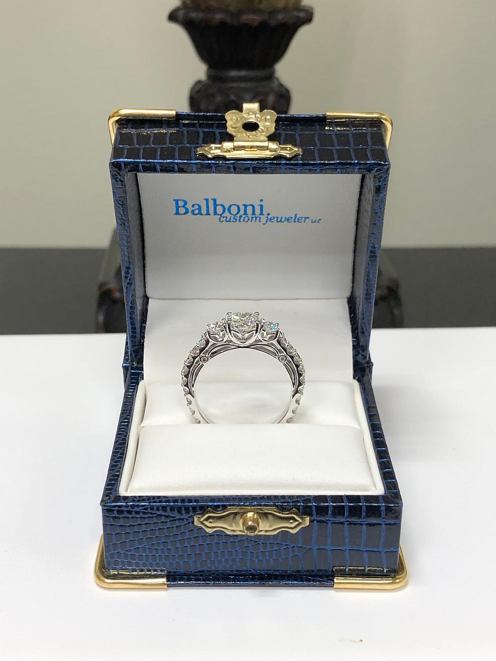 Custom-made 14K white gold diamond engagement ring.