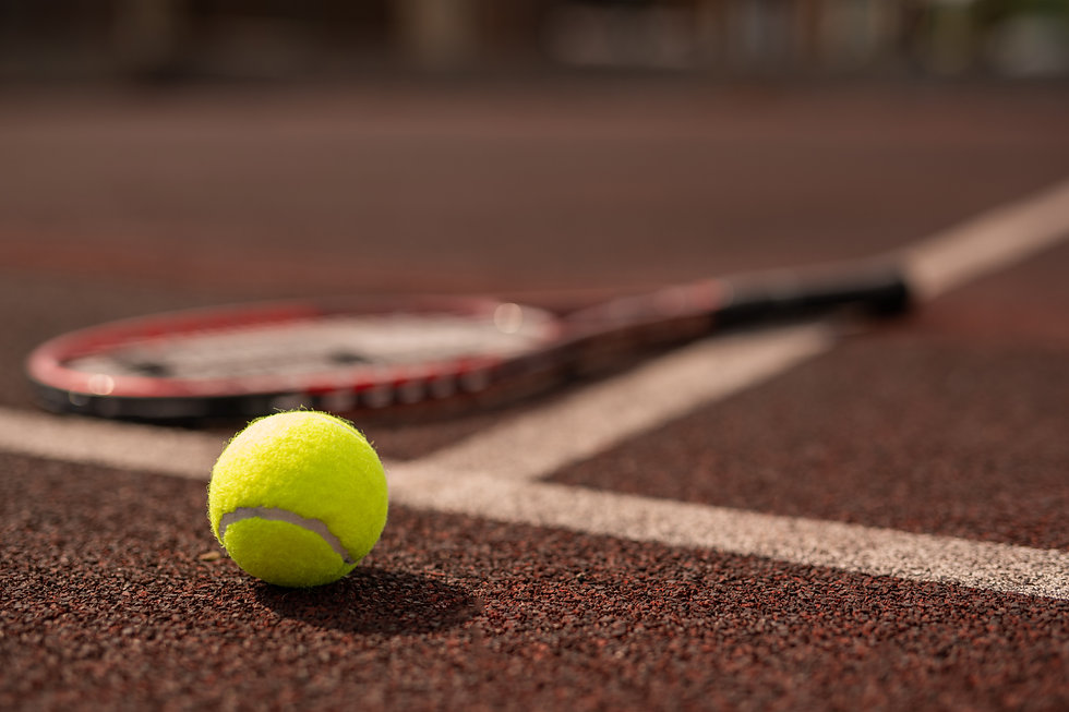yellow-tennis-ball-on-sports-playground-