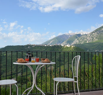 Breakfast with a view of the Maiella Mountains and a hilltop town!