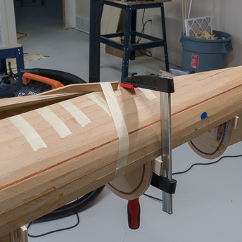 FITTING STRIPS TO BOW
