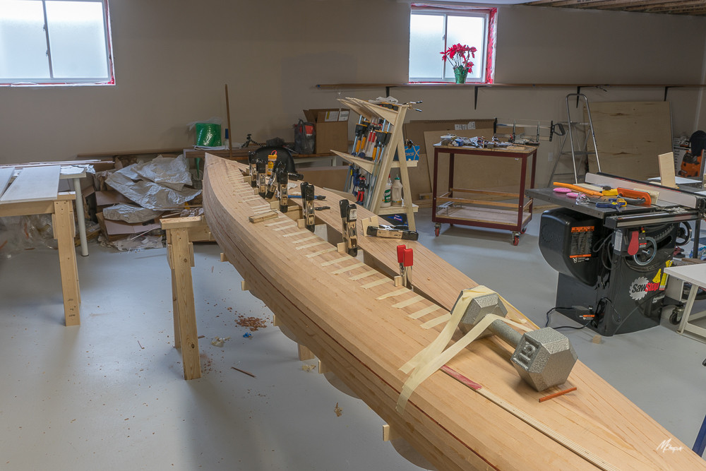 FITTING STRIPS TO SECOND SIDE OF KEEL