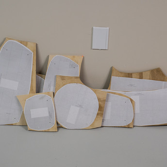 PLYWOOD FORMS ROUGHLY CUT TO SHAPE
