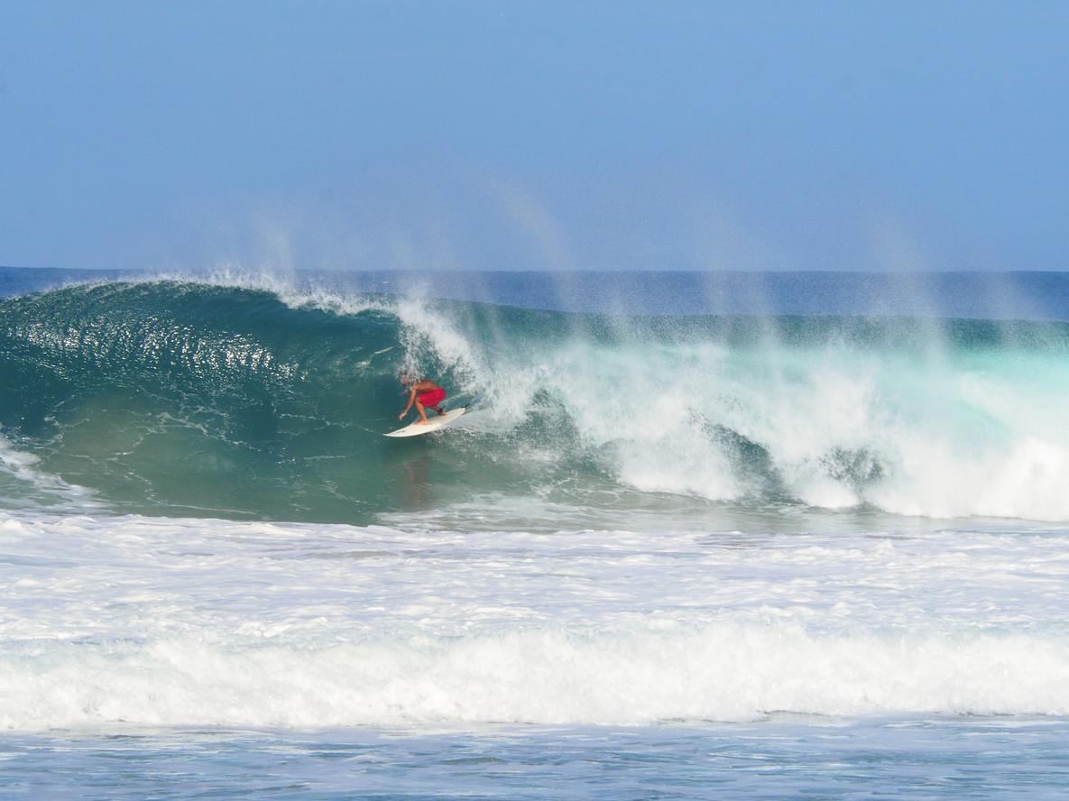 Surfer in the Pipeline of Playa Zicatela