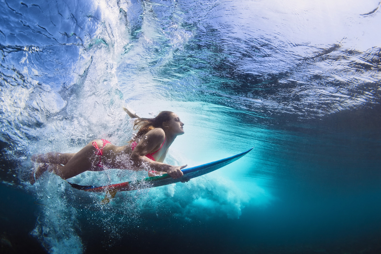 Young girl in bikini - surfer with surf