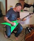 Adrian Moore Kawasaki green Flying V guitar