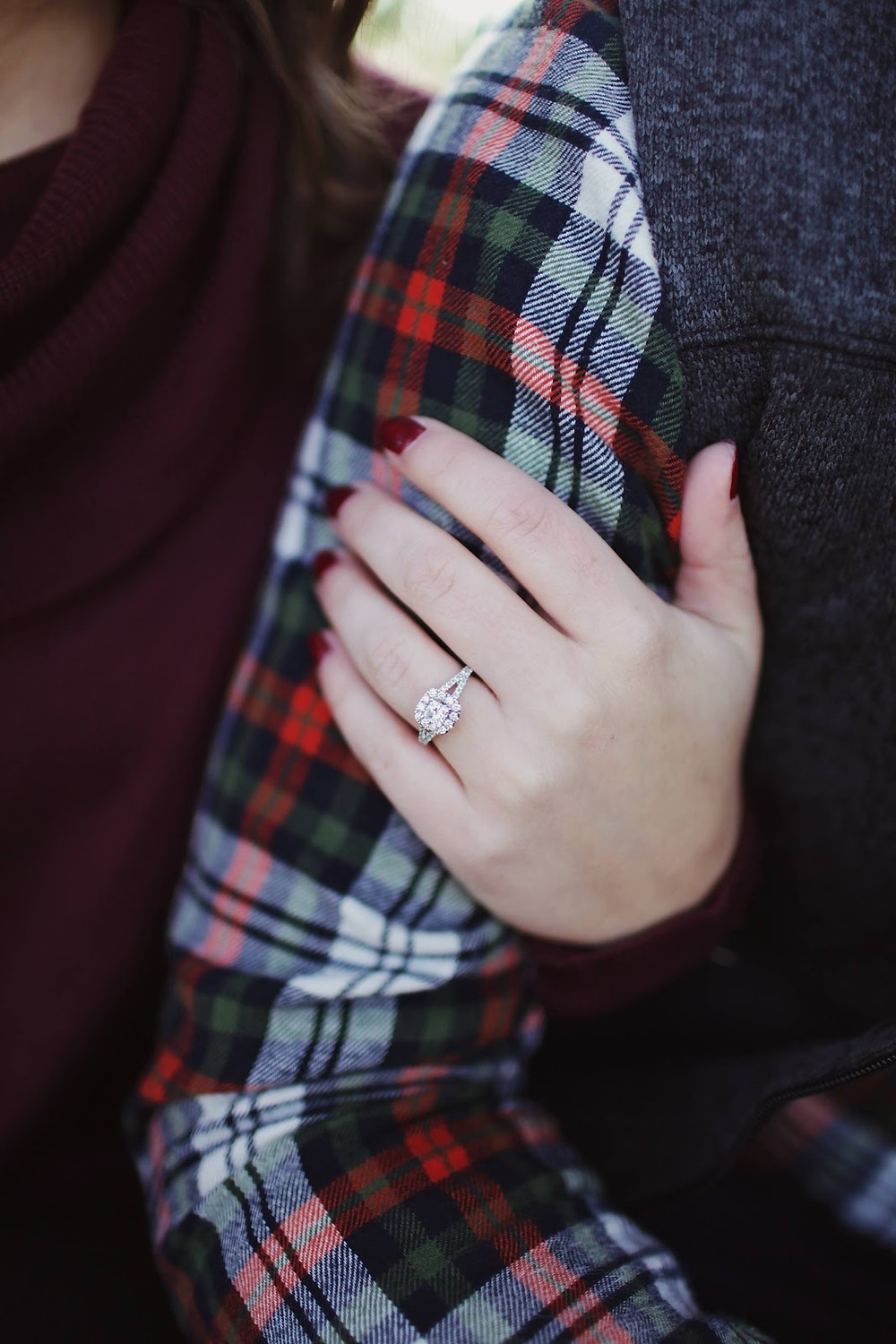 Diamond solitaire engagement ring on woman