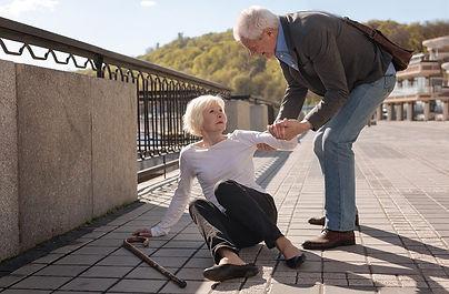bigstock-Elderly-couple-lady-falling-186