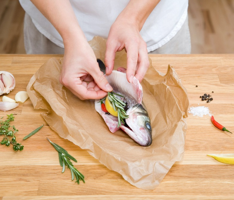 Cooking fish with herbs