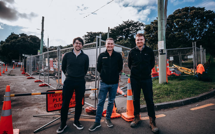 Amex Sanivar Managing Director Maximillian Vollenbroich and Hadlee and & Brunton CEO David Brunton stand together outside SaniTube job site in Wellington, New Zealand.