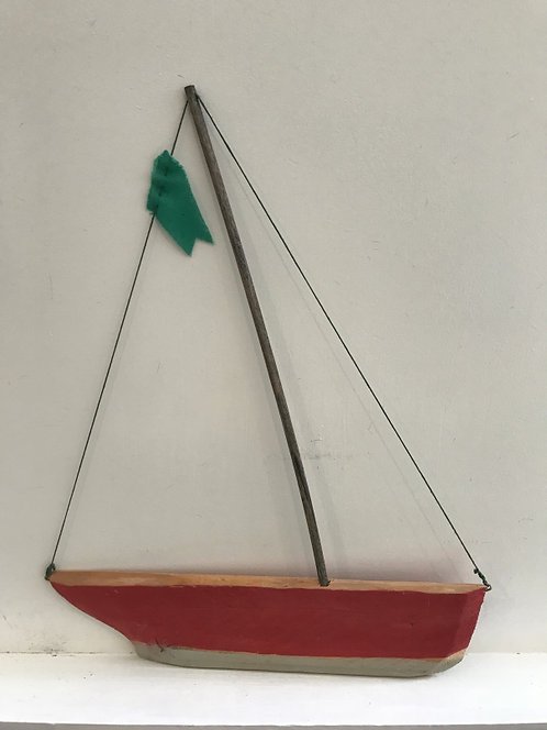 Boat with Red Hull and Green Flag