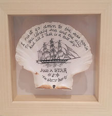 Kim Lynch scallop shell commissioned artwork. Pen and ink drawing on a scallop shell in a scrimshaw style.