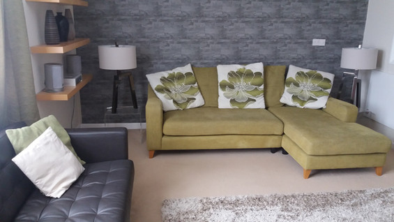 Riverside Apartment has a large, comfortable living room furnished in a contemporary style.