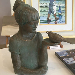 Girl with Bird a sculpture by Deryl Petrucci, Deryl Pettruci sculpture in bronze, bronze resin, copper resin and marble resin available from Waterside Gallery, St Ives. All Deryl Petrucci sculpture available from Waterside Gallery, St Ives Cornwall