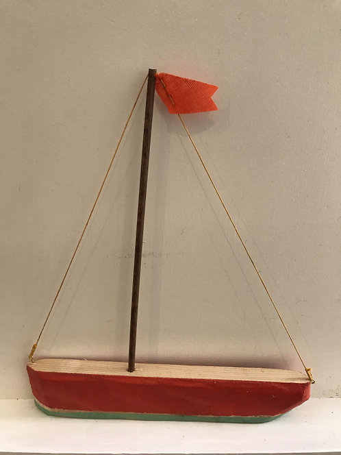 Boat with Red Hull and Red Flag