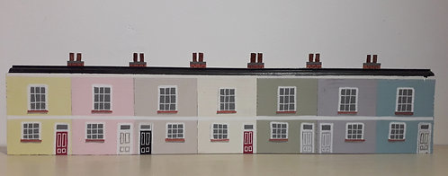 Row of Seven Pastel Cottages