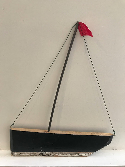Black Hulled Boat with Red Flag