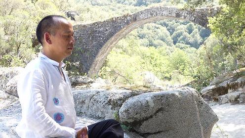 Jean-Philippe is meditating near a roman bridge in Corsica