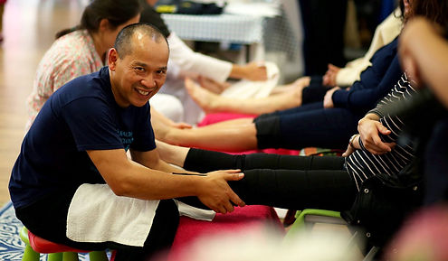 Jean-Philippe is massaging one of a patient leg