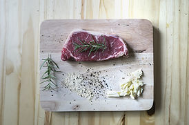 Raw Beef on Wooden Plate