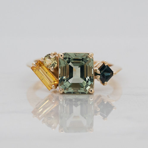 Amoura 18ct yellow gold dress ring, random set with mixed coloured sapphires and quartz in Melbourne