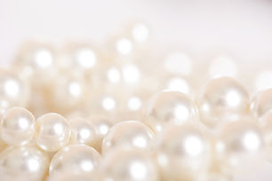 Pile of pearls on the white background.j