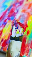 Macro image of paint brush loaded with acrylic paint