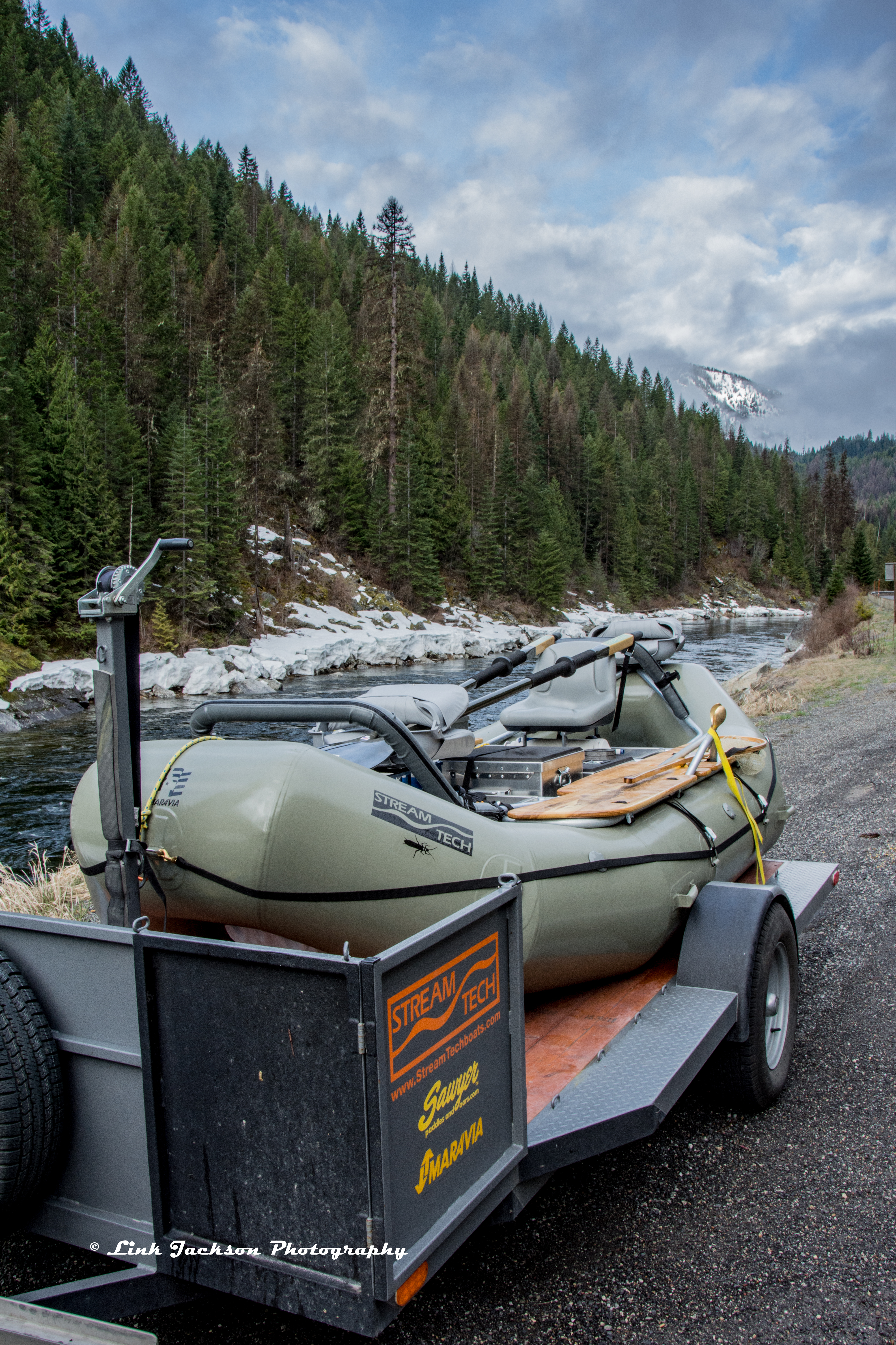 Boat and trailer by snowy upper Lochsa