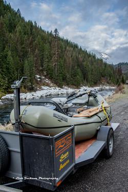 Boat and trailer by snowy upper Lochsa