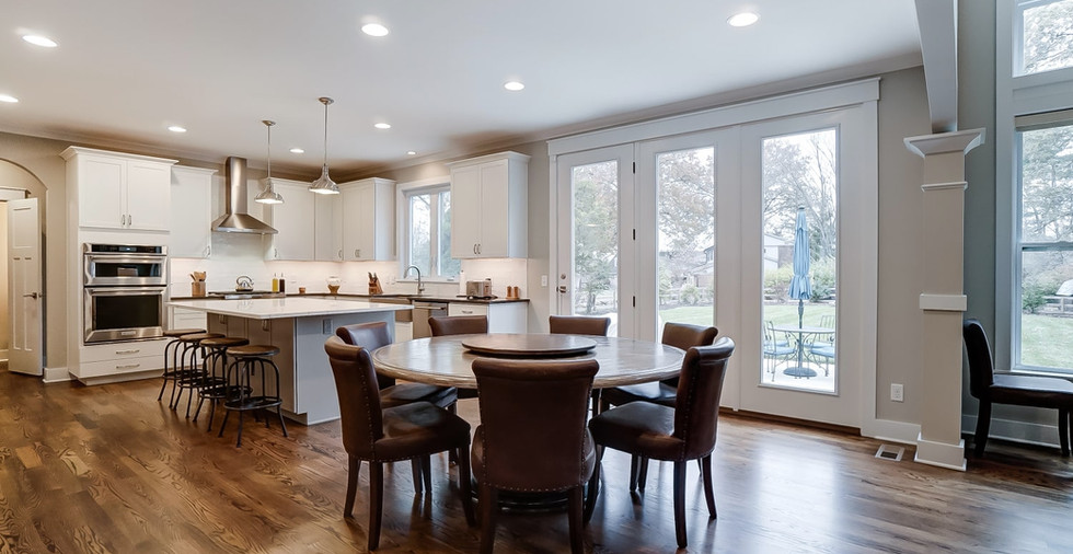 Spacious dining area and wooden flooring designed by Ashwood Homes