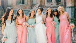 Beautiful bride with her pretty bridesma