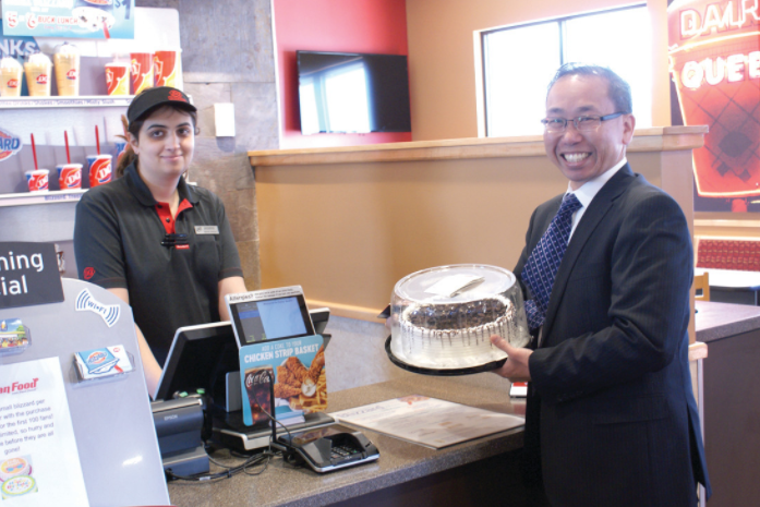 Cranston Mayor Allan Fung with a staff member at the newly opened Dairy Queen in Cranston.