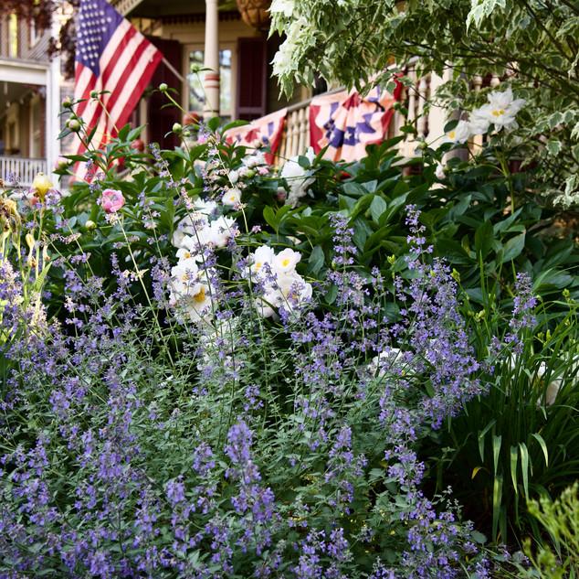 American Flag over Floral Arrangement