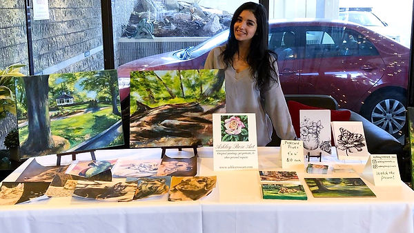 Ashley Rose Art showing her paintings in Manchester NH in 2019.