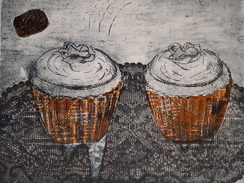Pair of orange cup cakes