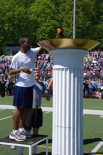 Jonathan Brunot lighting torch Special Olympics Westpoin