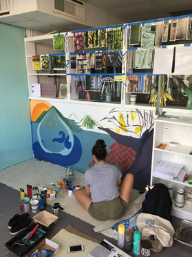 As I mentioned, it was important to me to collaborate with as many people as possible during my residency. I invited an artist to come and paint a mural to help transform the space.