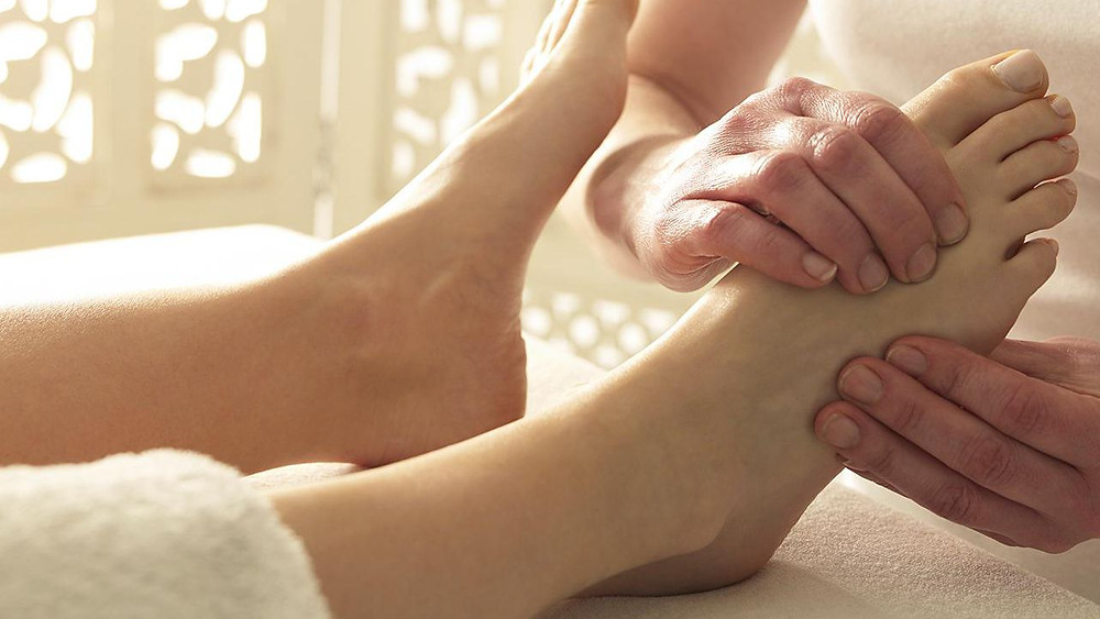 Clos up of woman's foot being massaged