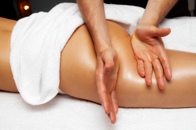 Lymphatic massage in thigh area to reduce cellulite