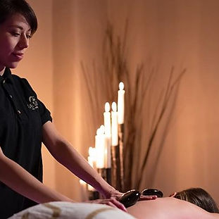 Hot stone massage therapy melts away ten