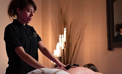 Hot stone massage therapy melts away ten
