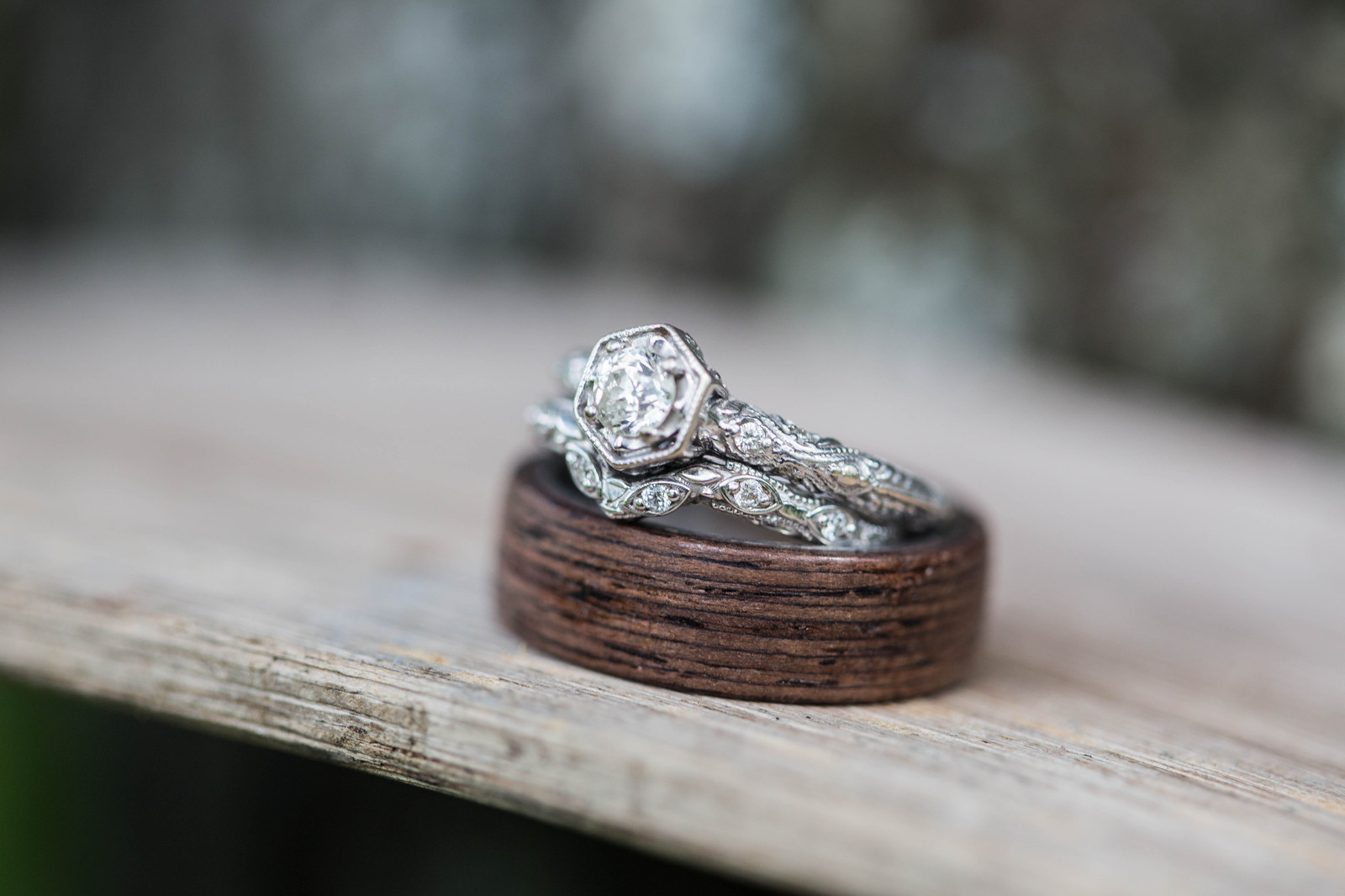 Wedding Bands Stacked On Wooden Wagon Wheel