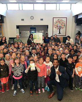 Derek Rhodes reads his book, Jimmy for the City, to students in Durham, North Carolina